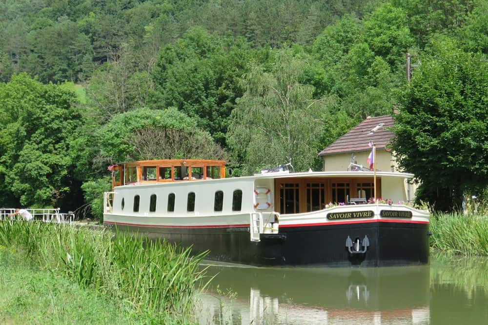 Savoir Barge on a river