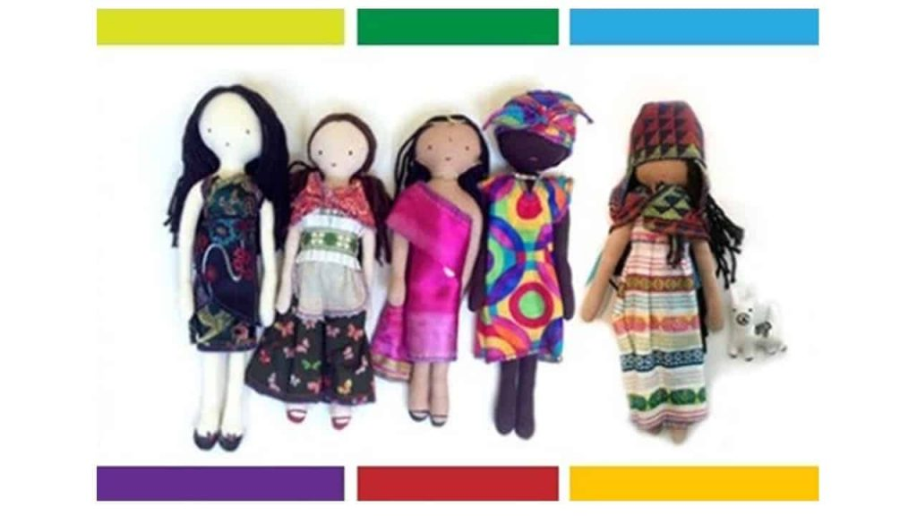 5 dolls wearing diverse cultural outfits